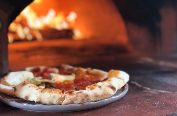 You can learn how to make pizza and cook it in our wood oven